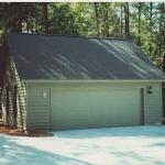 f Garage with single door, no windows in door
